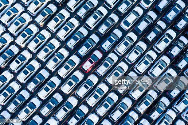 the aerial photograph of the outdoor warehouse of the new car. - repetition stock pictures, royalty-free photos & images