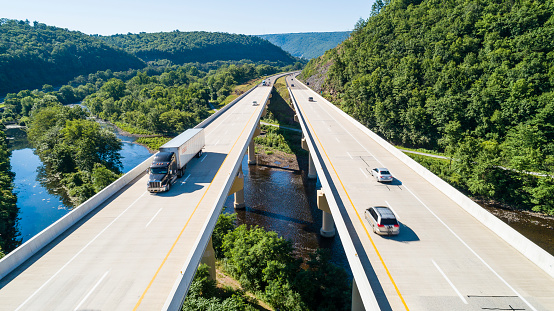 The aerial scenic view of the elevated highway on the high bridge over the Lehigh River at the Pennsylvania Turnpike. 1046074954