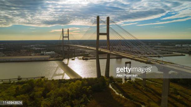 the aerial scenic view of the savannah and talmadge memorial bridge over the savannah river, on the border between georgia and south carolina. - savannah stock pictures, royalty-free photos & images