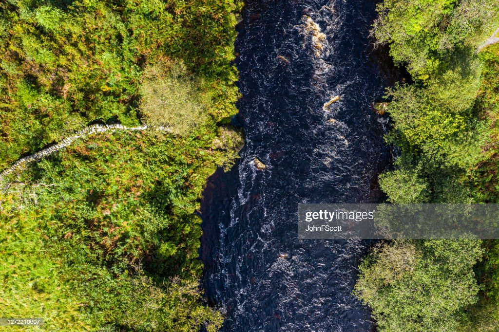 The aerial view from a drone of a river flowing in remote rural Dumfries and Galloway : Stock Photo