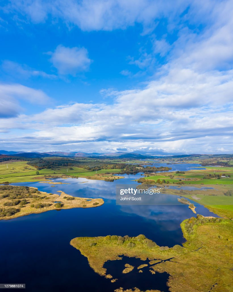 The aerial view from a drone of a slow moving river in rural Dumfries and Galloway south west Scotland : Stock Photo