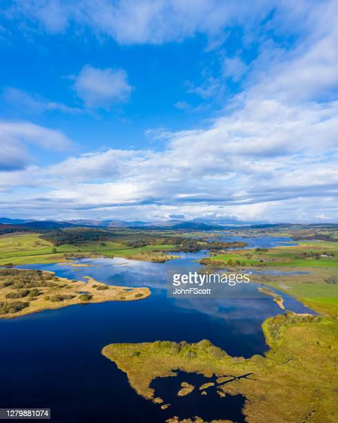 the aerial view from a drone of a slow moving river in rural dumfries and galloway south west scotland - johnfscott stock pictures, royalty-free photos & images