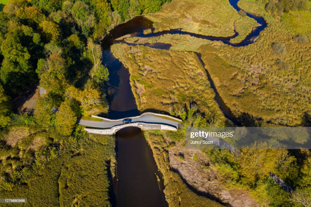 The aerial view from a drone of an old stone bridge in Dumfries and Galloway south west Scotland : Stock Photo