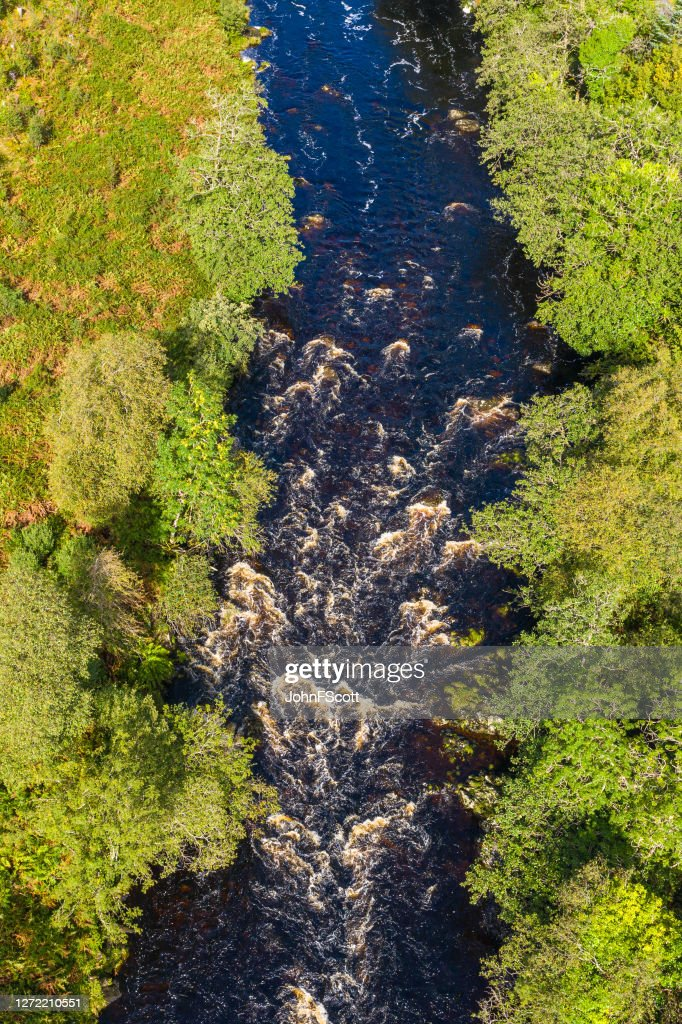 The aerial view looking straight down at a river in remote rural Dumfries and Galloway : Stock Photo