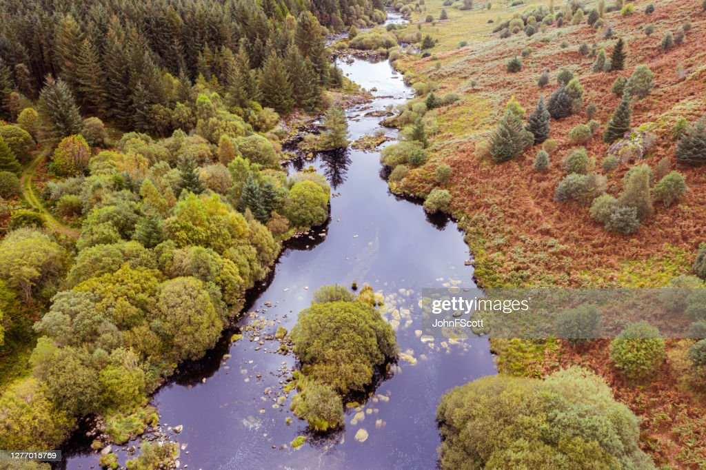 The aerial view of a river flowing through an area of rural Scotland : Stock Photo