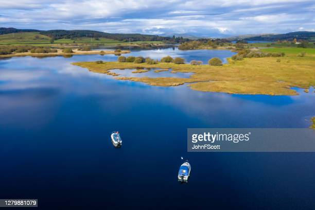 the aerial view of a slow moving river in rural dumfries and galloway south west scotland - johnfscott stock pictures, royalty-free photos & images