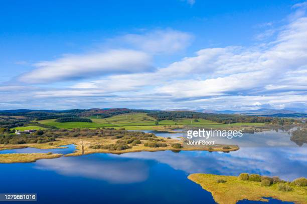 the aerial view of a slow moving stretch of water in rural dumfries and galloway south west scotland - johnfscott stock pictures, royalty-free photos & images