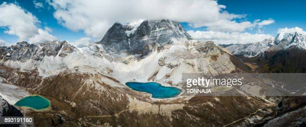 the aerial view of milk lake, five color lake and snowy mountain, yading, sichuan, china - nature reserve stock pictures, royalty-free photos & images