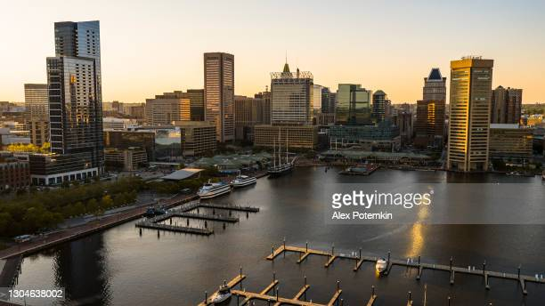 the aerial view of the inner harbor on patapsco river in baltimore, maryland, usa, at sunset. - baltimore maryland stock pictures, royalty-free photos & images