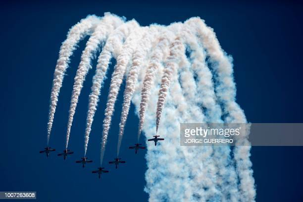 TOPSHOT The aerobatic demonstration team of the Spanish Air Force Patrulla Aguila perform during the 2018 International Torre del Mar Airshow on July...