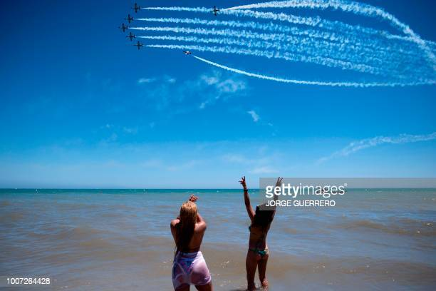 The aerobatic demonstration team of the Spanish Air Force Patrulla Aguila perform during the 2018 International Torre del Mar Airshow on July 29 2018