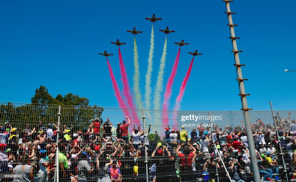 The aerobatic demonstration team of the Spanish Air Force 'Patrulla Aguila' performs during the Spanish Grand Prix at the Jerez Angel Nieto racetrack in Jerez de la Frontera on May 6, 2018.
