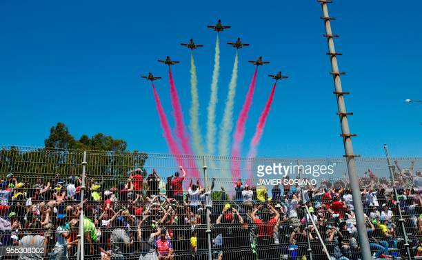 The aerobatic demonstration team of the Spanish Air Force Patrulla Aguila performs during the Spanish Grand Prix at the Jerez Angel Nieto racetrack...