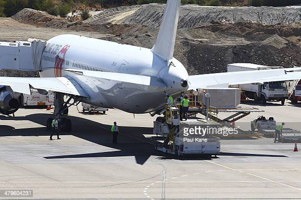 The Aeronexus Corporation's Boeing 767 used by the Rolling Stones is inspected by flight crew and engineers in readiness for takeoff at Perth...