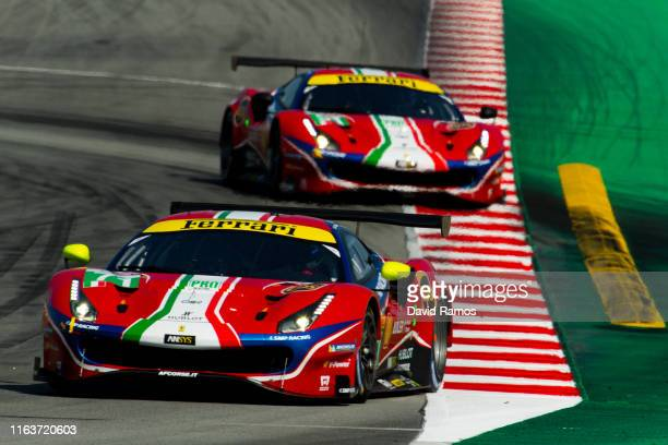 The AF Corse Ferrari 488 GTE EVO of Davide Rigon of Italy and Miguel Molina of Spain in action in front of The AF Corse Ferrari 488 GTE EVO of James...