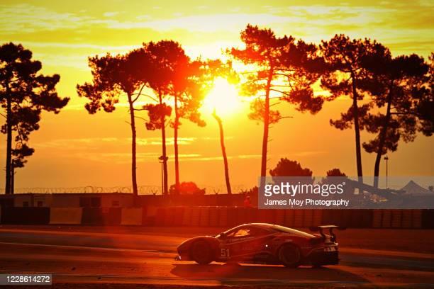 The AF Corse Ferrari 488 GTE EVO of James Calado, Daniel Serra, and Alessandro Pier Guidi in action at sunrise at the Circuit de la Sarthe on...