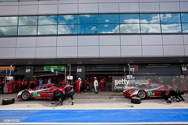 The AF Corse Ferrari F458 Italia driven by Andrea Bertolini of Italy and Olivier Beretta of Monaco and The AF Corse Ferrari F458 Italia driven by...