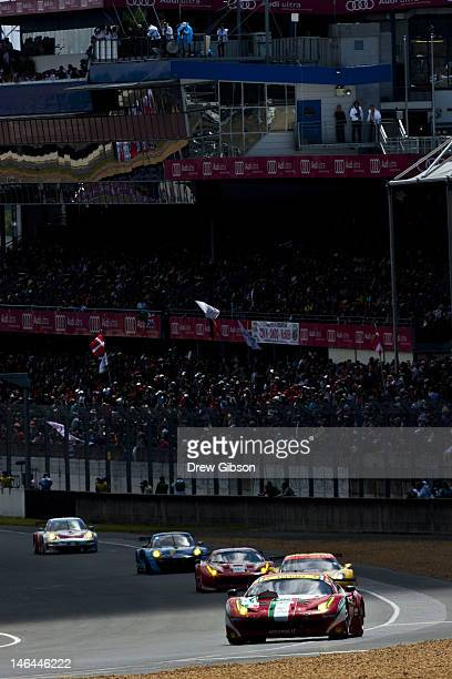The AF Corse Ferrari F458 Italia driven by Giancarlo Fisichella of Italy Toni Vilander of Finland and Gianmaria Bruni of Italy during the Le Mans 24...