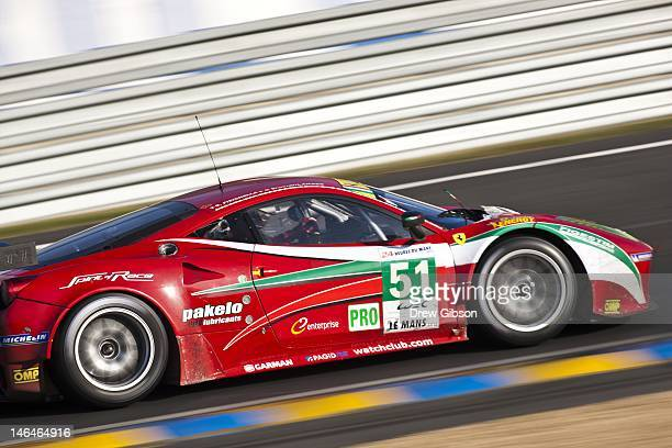 The AF Corse Ferrari F458 Italia driven by Giancarlo Fisichella of Italy Toni Vilander of Finland and Gianmaria Bruni of Italy during the field...