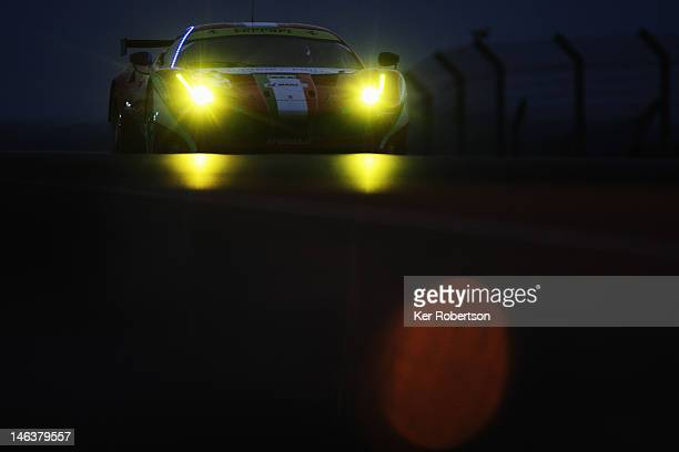 The AF Corse Michael Waltrip Ferrari 458 of Robert Kauffman Rui Aguas and Brian Vickers drives during qualifying for the Le Mans 24 Hour race at the...