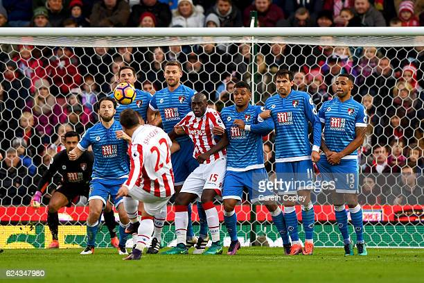 The AFC Bournemouth players attempt to stop a Xherdan Shaqiri of Stoke City freekick during the Premier League match between Stoke City and AFC...
