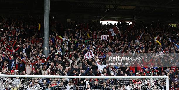 The AFC Bournemouth supporters celebrate in the stands after winning the Championship during the Sky Bet Championship match between Charlton Athletic...