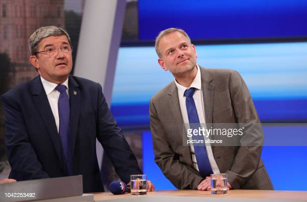 The AfD frontrunner LeifErik Holm and the CDU frontrunner Lorenz Caffier take part in a TV round after the announcement of the first results in the...