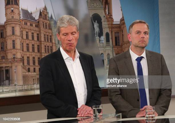 The AfD frontrunner LeifErik Holm and the frontrunner of The Left Helmut Holtertake part in a TVroundafter the announcement of the first results...