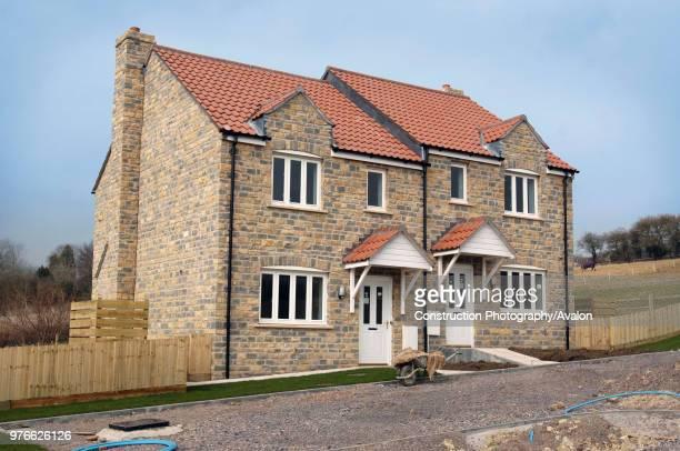 The affordable housing built by Glastonbury Rock Festival Founder Michael Eavis in the village of Pilton Somerset UK