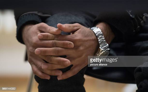 The Afghan Haschmatullah F folds his hands during a press conference in Tuebingen Germany 14 December 2017 The man had been deported to his homeland...