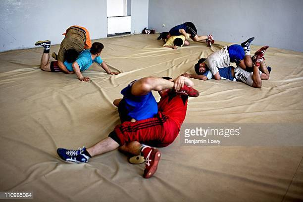 The Afghan Olympic Wrestling Team works out in their padded practice facility on April 9, 2007 in Kabul, Afghanistan. In the 6 years since the US...