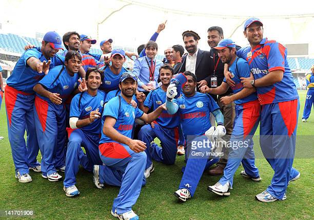 The Afghan team celebrate victory after the ICC World Twenty20 1st Qualifying Final between Afghanistan and Namibia at the Dubai International...