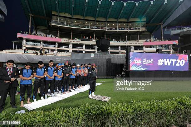 The Afghanistan team perform evening prayers before the ICC World Twenty20 India 2016 match between Sri Lanka and Afghanistan at Eden Gardens on...