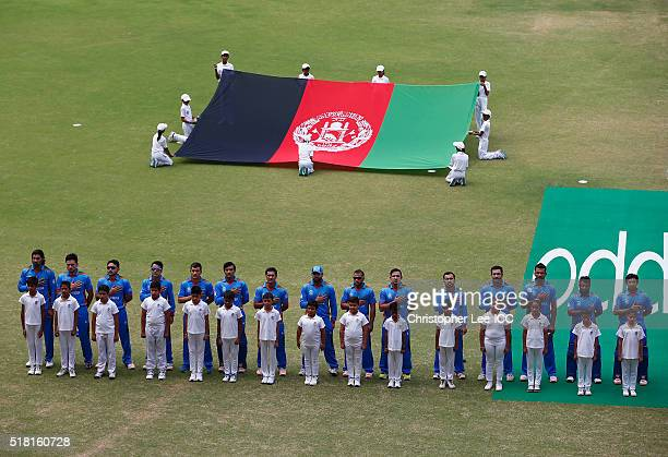 The Afghanistan team sing their national anthem during the ICC World Twenty20 India 2016 Group 1 match between Afghanistan and West Indies at the...