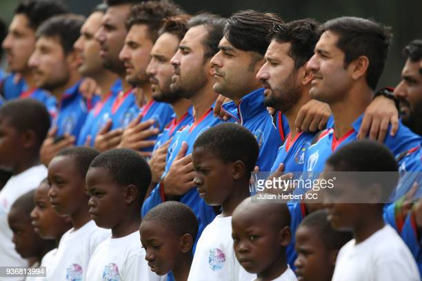 The Afghanistan team take part in the line up before The ICC Cricket World Cup Qualifier between Ireland and Afghanistan at The Harare Sports Club on...