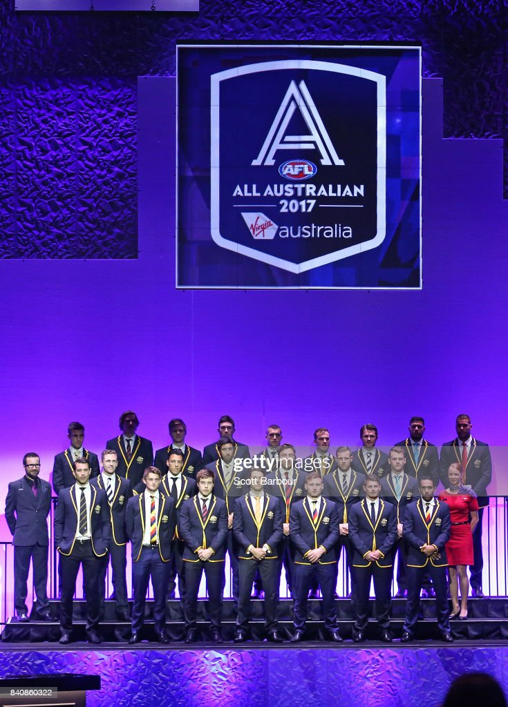 The AFL All Australian team pose on stage during the AFL All Australian team announcement at the Palais Theatre on August 30, 2017 in Melbourne, Australia.
