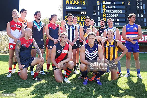 The AFL team captains pose together during the 2014 AFL Season Launch at Adelaide Oval on March 5 2014 in Adelaide Australia