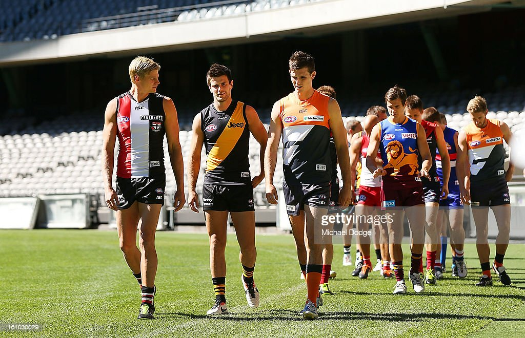 The AFL team captains walk onto the field during the AFL Captains media Day at Etihad Stadium on March 19, 2013 in Melbourne, Australia.