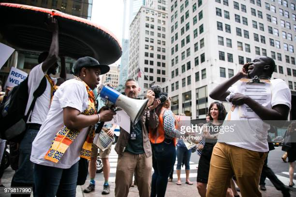The African Communities Together and the City of Refuge Coalition march and rally to Stop the Refugee Ban Save Asylum Defend Temporary Protected...