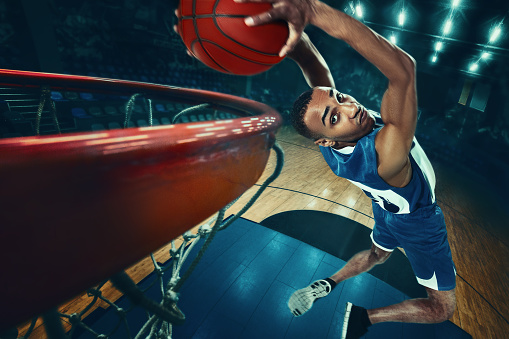 The african man basketball player jumping with ball 1004186904