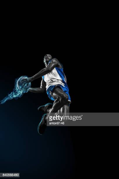 The african man basketball player jumping with ball