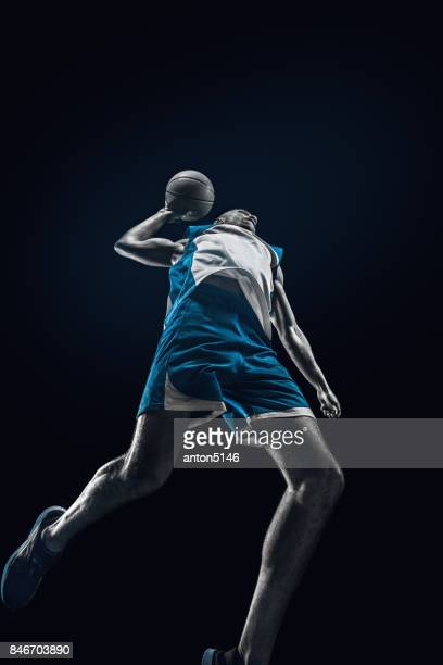 the african man basketball player jumping with ball - action movie stock pictures, royalty-free photos & images