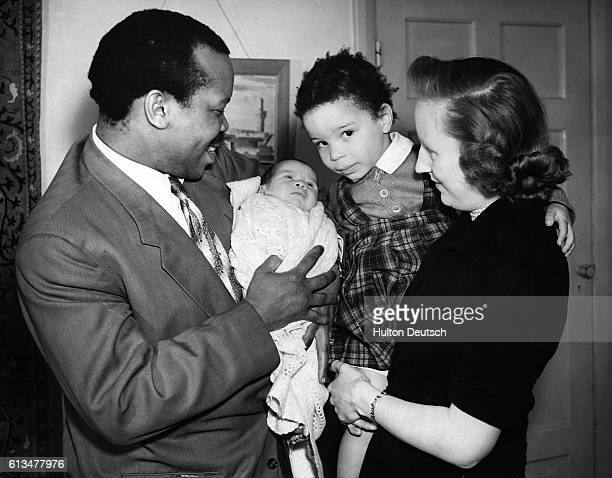 The African politician Seretse Khama at home in Surrey with his wife Ruth and their daugher Jacqueline and baby son Seretse 1953