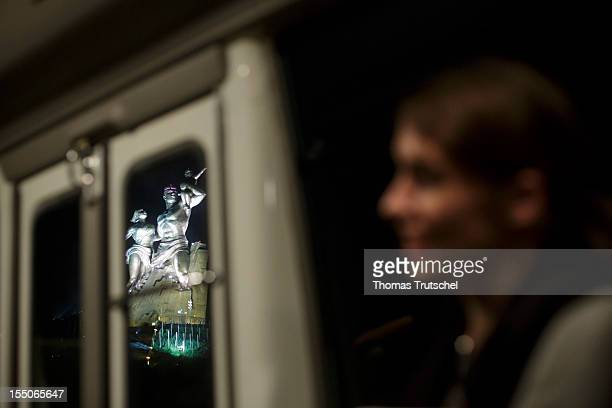 The African Renaissance Monument is pictured out of a bus on October 31 2012 in Dakar Senegal The Monument mark Senegal's 50 years of independence...
