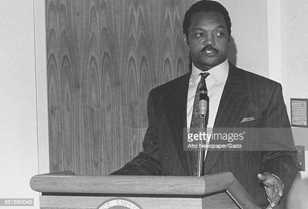 The AfricanAmerican politician and pastor Jesse Jackson at a lectern giving a speech at a fundraiser December 5 1973
