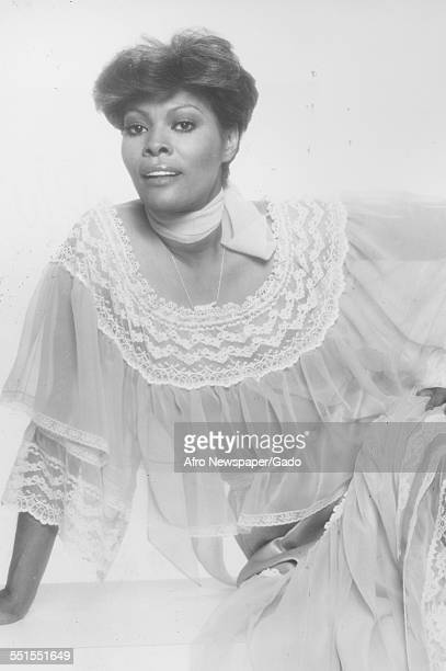The AfricanAmerican singer Dionne Warwick smiling 1964