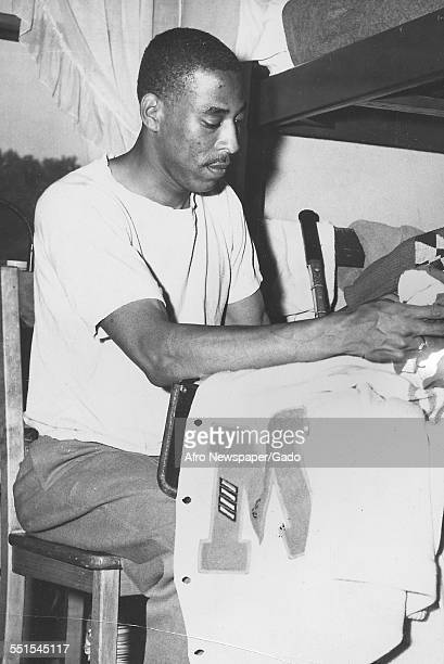 The AFRO cameraman Bob Tyler packing his kit for a running race and the caption reads Bob is as meticulous as he is fast 1943