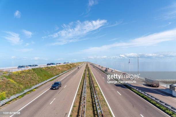 the afsluitdijk dam in the north sea, netherlands - levee stock pictures, royalty-free photos & images