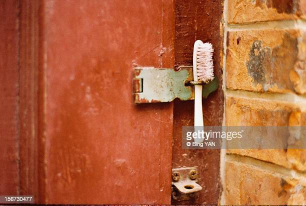 the after-life of a used toothbrush - door lock stock pictures, royalty-free photos & images