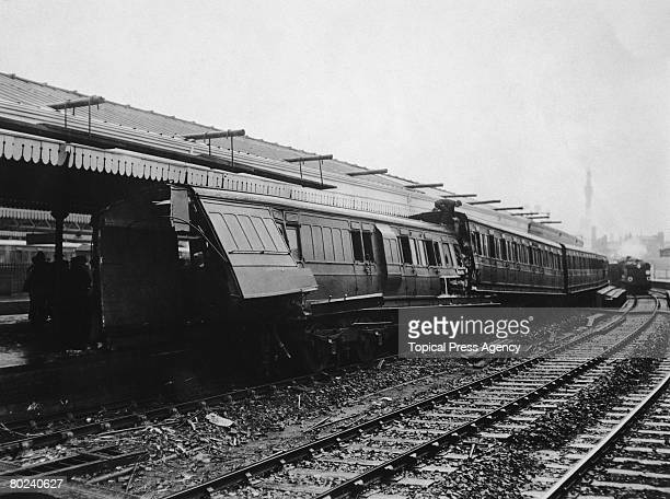 The aftermath of a train crash in which a light engine of the London South Western Railway collided with a stationary Aldershot to Waterloo passenger...